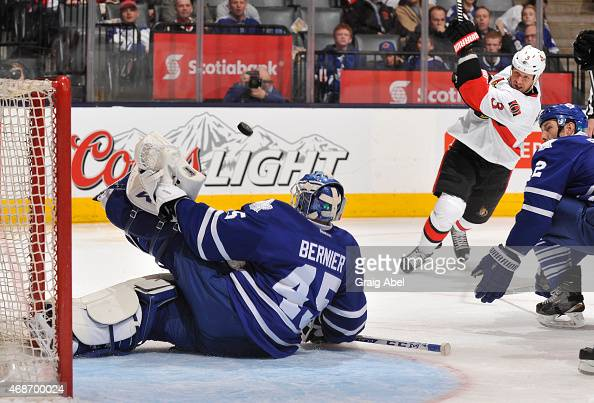 Marc Methot of the Ottawa Senators shoots the puck as Jonathan Bernier of the Toronto Maple Leafs makes a pad save during NHL game action April 5...