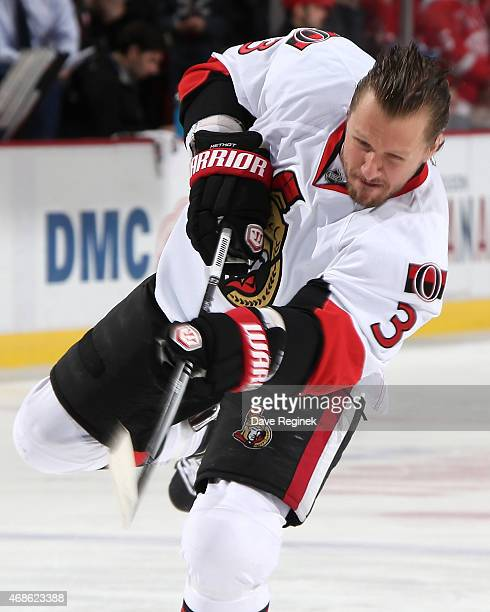 Marc Methot of the Ottawa Senators shoots the puck in warmups prior to the NHL game against the Detroit Red Wings on March 31 2015 at Joe Louis Arena...