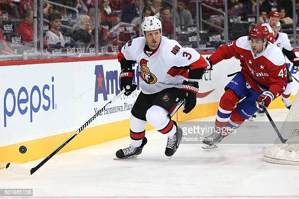 Marc Methot of the Ottawa Senators skates past Tom Wilson of the Washington Capitals in the second period at Verizon Center on December 16 2015 in...