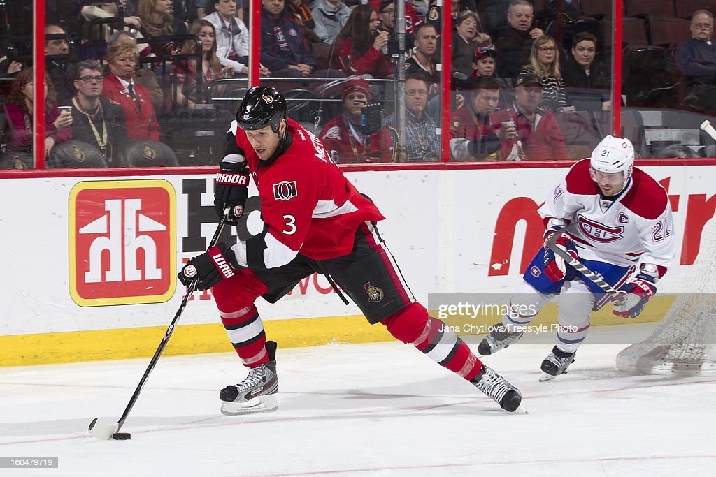 Marc Methot #3 of the Ottawa Senators skates with the puck away from Brian Gionta #21 of the Montreal Canadiens during an NHL game at Scotiabank Place on January 30, 2013 in Ottawa, Ontario, Canada.