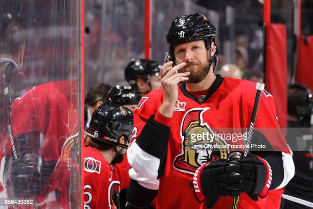 Marc Methot of the Ottawa Senators uses smelling salts against the Pittsburgh Penguins in Game Four of the Eastern Conference Final during the 2017...