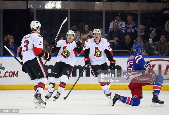 Marc Methot Shane Prince and David Dziurzynski of the Ottawa Senators celebrate Methot's goal at 601 of the first period against the New York Rangers...