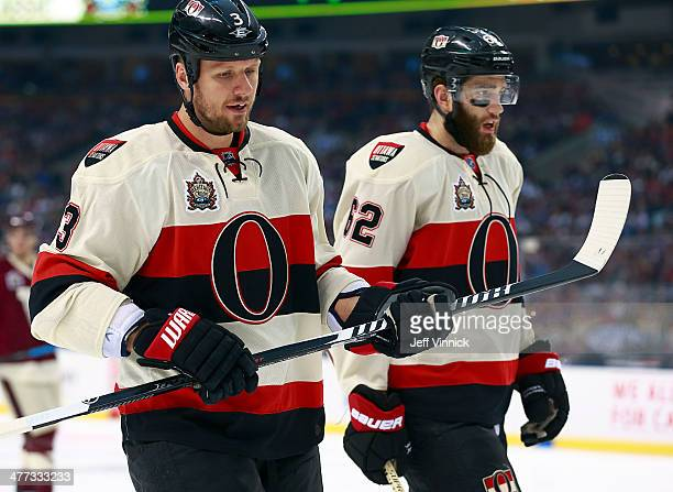 Marc Methot talks to teammate Eric Gryba of the Ottawa Senators during the 2014 Tim Hortons NHL Heritage Classic against the Vancouver Canucks at BC...