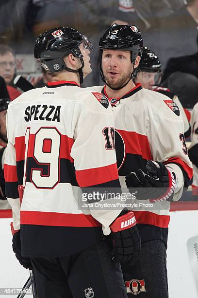 Marc Methot talks to teammate Jason Spezza of the Ottawa Senators during an NHL game against the Montreal Canadiens at Canadian Tire Centre on April...
