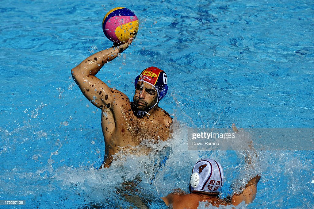 Marc Minguell of Spain in action against Vanja Udovicic of Serbia during the Men's Water Polo fifth to eighth place match between Spain and Serbia...
