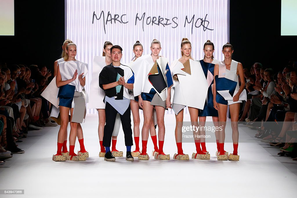 Marc Morris Mok and models acknowledge the applause of the audience after the fashion talent award 'Designer for Tomorrow' by Peek & Cloppenburg and Fashion ID hosted by Alber Elbaz during the Mercedes-Benz Fashion Week Berlin Spring/Summer 2017 at Erika Hess Eisstadion on June 30, 2016 in Berlin, Germany.