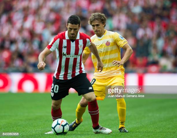 Marc Muniesa of Girona FC competes for the ball with Aritz Aduriz of Athletic Club during the La Liga match between Athletic Club and Girona at San...