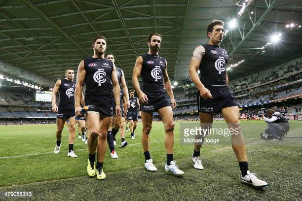 Marc Murphy Andew Walker and Michael Jamison of the Blues walk off after their defeat during the round one AFL match between the Carlton Blues v Port...