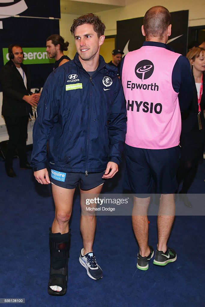 <a gi-track='captionPersonalityLinkClicked' href=/galleries/search?phrase=Marc+Murphy&family=editorial&specificpeople=545927 ng-click='$event.stopPropagation()'>Marc Murphy</a> of the Blues hobbles with his moonboot after their win in the round 10 AFL match between the Carlton Blues and the Geelong Cats at Etihad Stadium on May 29, 2016 in Melbourne, Australia.