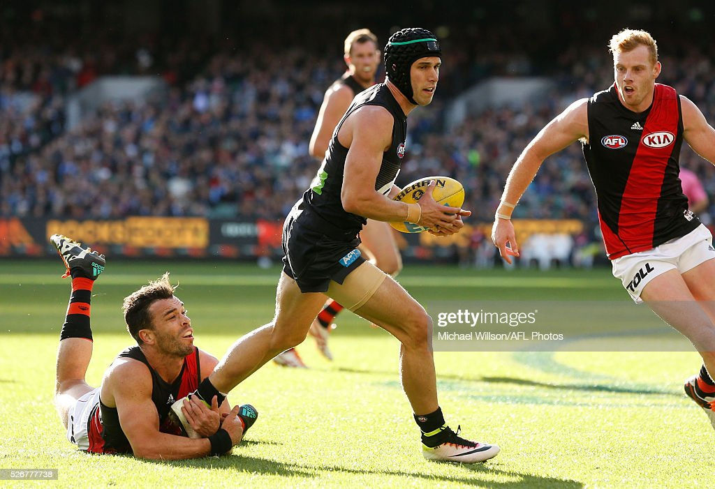 Marc Murphy of the Blues is tackled by Ryan Crowley of the Bombers during the 2016 AFL Round 06 match between the Carlton Blues and the Essendon Bombers at the Melbourne Cricket Ground, Melbourne on May 1, 2016.
