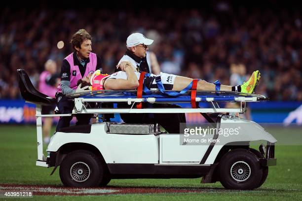 Marc Murphy of the Blues is taken from the field after getting injured during the round 22 AFL match between the Port Adelaide Power and the Carlton...