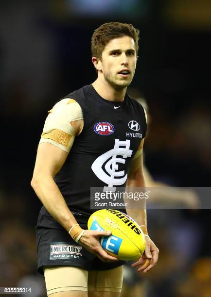 Marc Murphy of the Blues runs with the ball during the round 22 AFL match between the Carlton Blues and the Hawthorn Hawks at Etihad Stadium on...