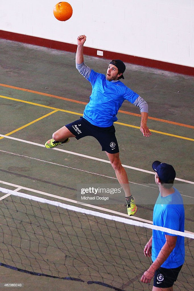 Marc Murphy spikes the ball in a game of Volleyball with teamate Robert Warnock during the Carlton Blues AFL training camp on January 28, 2015 in Mount Buller, Australia.