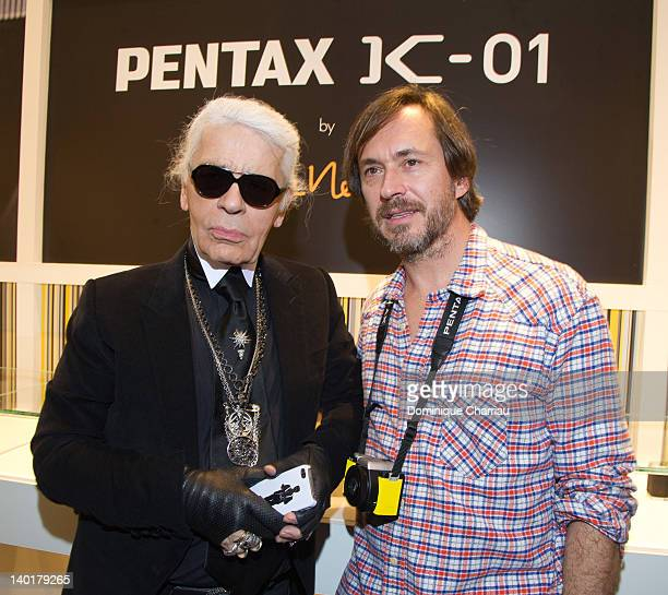 Marc Newson and Karl lagerfeld attend the Marc Newson Pentax The Unveiling Of 'K01' Champagne Cocktail At Colette during Paris Fashion Week at...