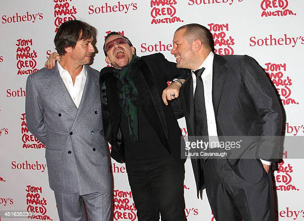 Marc Newson Bono and Jonathan Ive attend 2013 Auction Celebrating Masterworks Of Design and Innovation on November 23 2013 in New York City