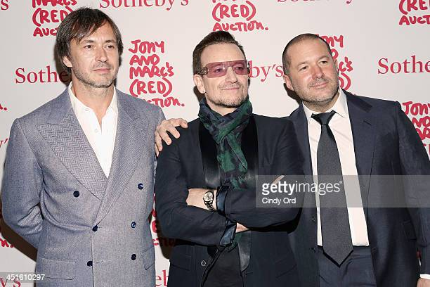 Marc Newson Bono and Jony Ive attend Jony And Marc's Auction at Sotheby's on November 23 2013 in New York City Photo by Cindy Ord/Getty Images for