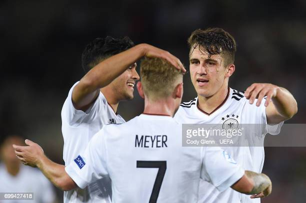Marc Oliver Kempf of Germany celebrates with team mates after he scored his side's second goal during their UEFA Under21 Championship Group C match...
