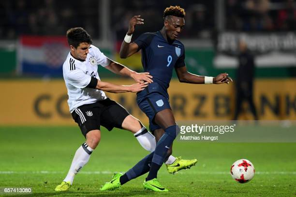 Marc Oliver Kempf of Germany challenges Abraham Tammy of England during the U21 international friendly match between Germany and England at...