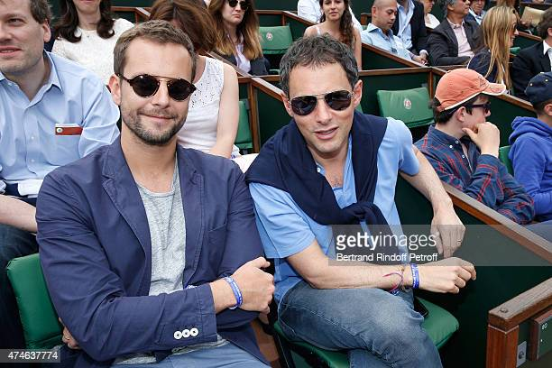 Marc Olivier Fogiel and Francois attend the 2015 Roland Garros French Tennis Open at Roland Garros on May 24 2015 in Paris France