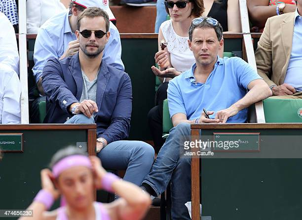 Marc Olivier Fogiel and his husband Francois Roelants attend day 1 of the French Open 2015 held at Roland Garros on May 24 2015 in Paris France