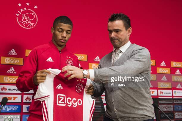Marc Overmars of Ajax hands the shirt of Ajax to David Neres of Ajaxduring the press presentation of David Neres at the Amsterdam Arena on February...
