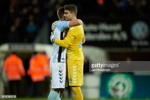 Marc Pedersen of SonderjyskE and Goalkeeper Sebastian Mielitz of SonderjyskE celebrate after the Danish Alka Superliga match between SonderjyskE and...