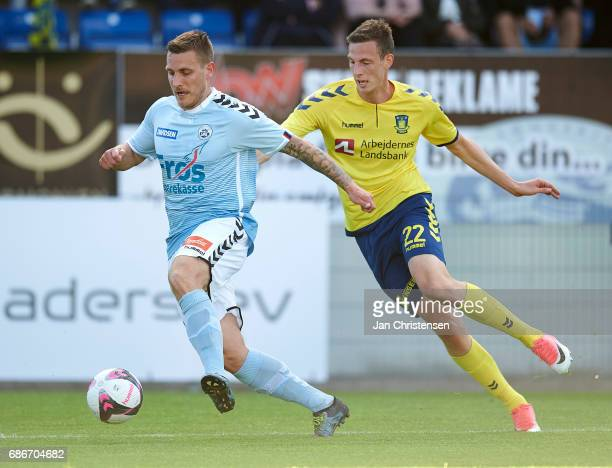 Marc Pedersen of SonderjyskE and Gustaf Nilsson of Brondby IF compete for the ball during the Danish Alka Superliga match between SonderjyskE and...