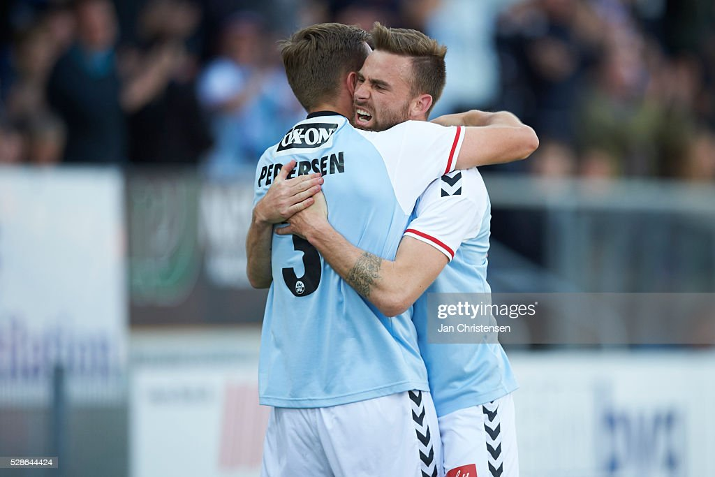 Marc Pedersen of SonderjyskE and Janus Drachmann of SonderjyskE celebrate the 1-0 goal from Marc Dal Hende during the Danish Alka Superliga match between SonderjyskE and Esbjerg fB at Sydbank Park on May 06, 2016 in Haderslev, Denmark.