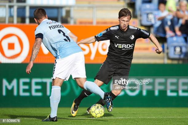 Marc Pedersen of SonderjyskE and Marvin Pourié of Randers FC compete for the ball during the Danish Alka Superliga match between SonderjyskE and...