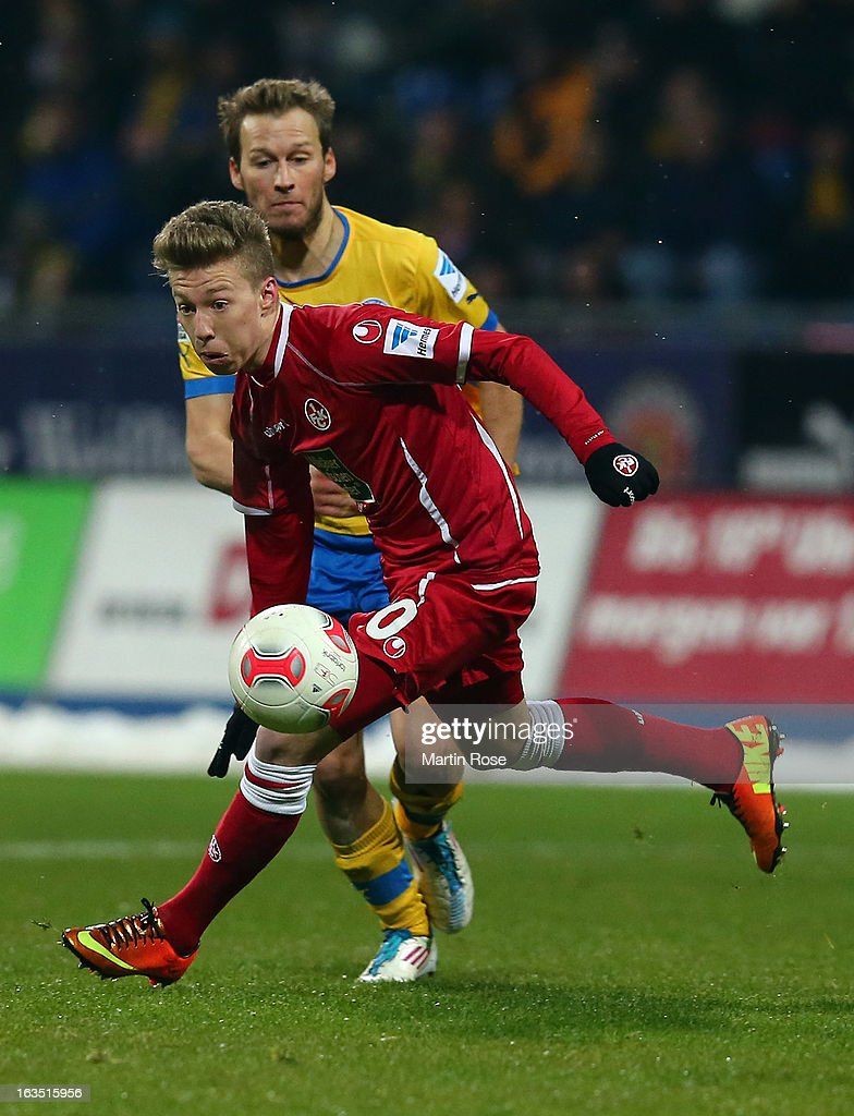 Marc Pfitzner (R) of Braunschweig and Mitchell Weiser (L) of Kaiserslautern battle for the ball during the second Bundesliga match between Eintracht Braunschweig and 1. FC Kaiserslautern at Eintracht Stadium on March 11, 2013 in Braunschweig, Germany.