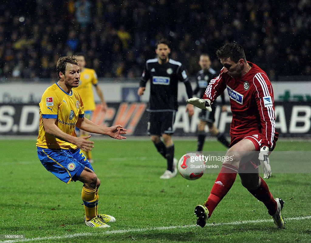 Marc Pfitzner of Braunschweig has a shot saved by Jasmin Fejzic of Aalen during the second Bundesliga match between Eintracht Braunschweig and VfR Aalen at Eintracht Stadion on February 8, 2013 in Braunschweig, Germany.
