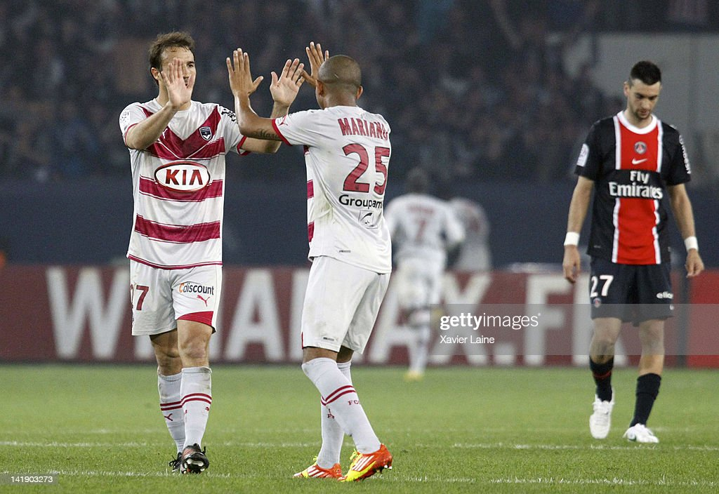 <a gi-track='captionPersonalityLinkClicked' href=/galleries/search?phrase=Marc+Planus&family=editorial&specificpeople=708262 ng-click='$event.stopPropagation()'>Marc Planus</a> and Mariano of Bordeaux celebrate a goal and <a gi-track='captionPersonalityLinkClicked' href=/galleries/search?phrase=Javier+Pastore&family=editorial&specificpeople=5857872 ng-click='$event.stopPropagation()'>Javier Pastore</a> (R) of Paris Saint-Germain is disapointed during the French Ligue 1 between Paris Saint-Germain and FC Girondins de Bordeaux at Parc Des Princes on March 25, 2012 in Paris, France.