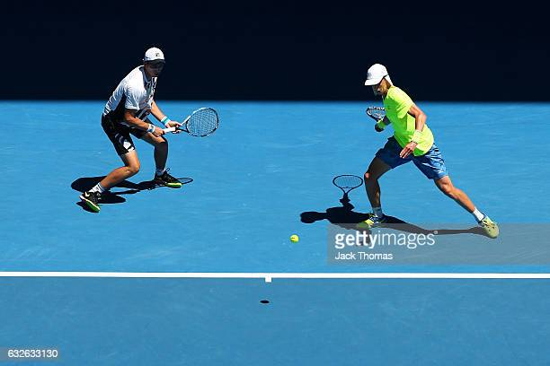 Marc Polmans and Andrew Whittington of Australia compete in their quarterfinal match against PierreHugues Herber and Nicolas Mahut of France on day...