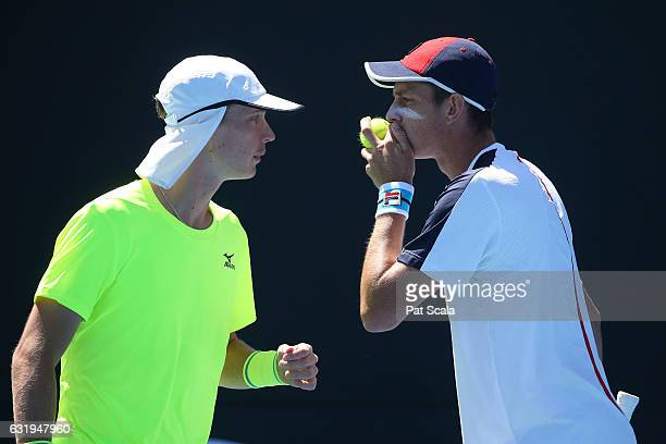 Marc Polmans and Andrew Whittington of Australia talk tactics in their first round doubles match against YenHsun Lu and Jiri Vesely on day three of...