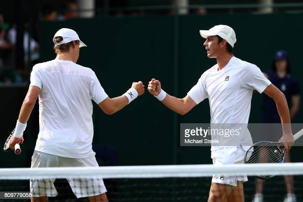 Marc Polmans of Australia and Andrew Whittington of Australia celebrate during the Gentlemen's Doubles first round match against Bob Bryan of the...