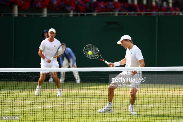 Marc Polmans of Australia and Andrew Whittington of Australia in action during the Gentlemen's Doubles first round match against Bob Bryan of the...