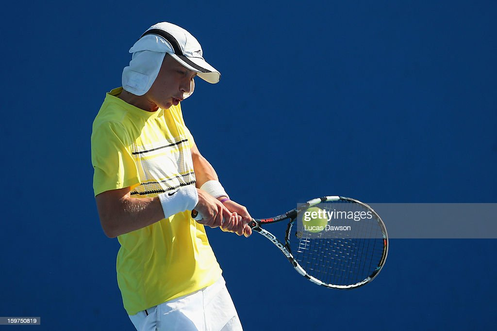 Marc Polmans of Australia plays a backhand in his first round doubles match with Akira Santillan of Australia against Hyeon Chung and Duk-Young Kim of Korea during the 2013 Australian Open Junior Championships at Melbourne Park on January 20, 2013 in Melbourne, Australia.