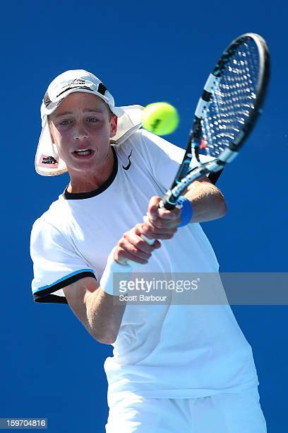 Marc Polmans of Australia plays a backhand in his first round match against Nicolas Jarry of the United States during the 2013 Australian Open Junior...