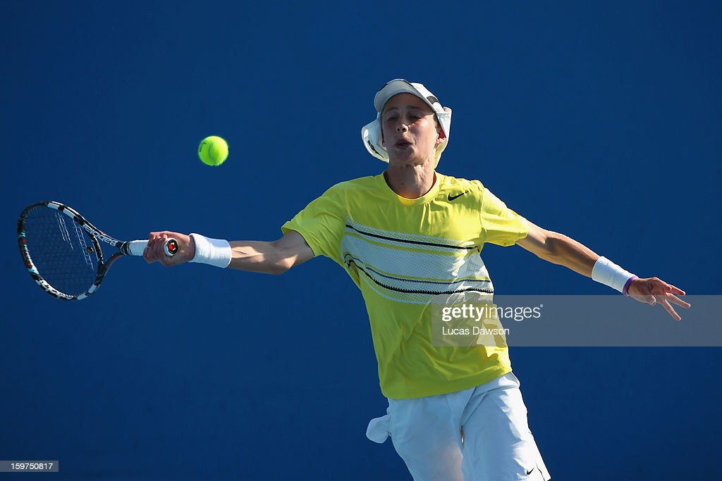 Marc Polmans of Australia plays a forehand in his first round doubles match with Akira Santillan of Australia against Hyeon Chung and Duk-Young Kim of Korea during the 2013 Australian Open Junior Championships at Melbourne Park on January 20, 2013 in Melbourne, Australia.
