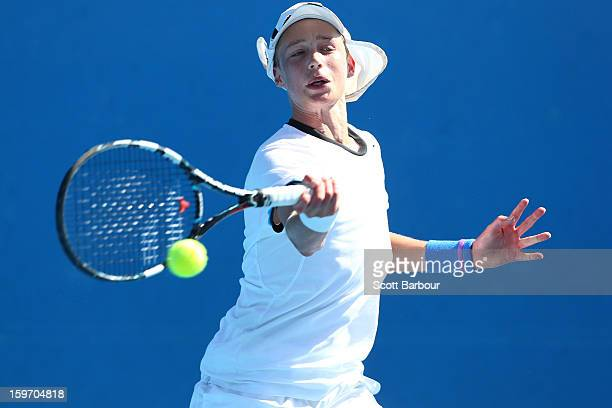 Marc Polmans of Australia plays a forehand in his first round match against Nicolas Jarry of the United States during the 2013 Australian Open Junior...