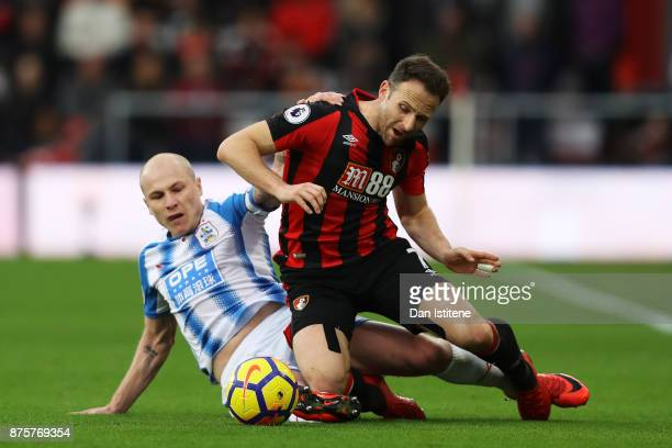 Marc Pugh of AFC Bournemouth and Aaron Mooy of Huddersfield Town compete for the ball during the Premier League match between AFC Bournemouth and...
