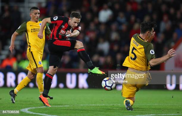 Marc Pugh of AFC Bournemouth is blocked by Lewis Dunk of Brighton and Hove Albion during the Premier League match between AFC Bournemouth and...