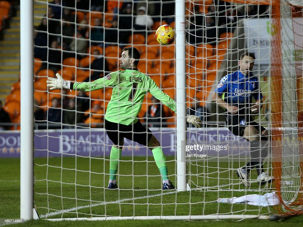 Marc Pugh of AFC Bournemouth steers the ball past Joe Lewis, Goalkeeper of Blackpool for his goal during the Sky Bet Championship match between Blackpool and Bournemouth at Bloomfield Road on December 20, 2014 in Blackpool, England.