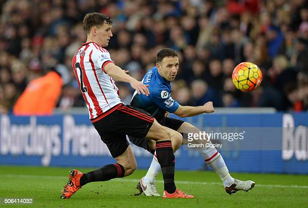 Marc Pugh of Bournemouth and Billy Jones of Sunderland compete for the ball during the Barclays Premier League match between Sunderland and AFC...