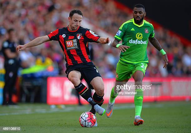 Marc Pugh of Bournemouth and Yann M'Vila of Sunderland compete for the ball during the Barclays Premier League match between AFC Bournemouth and...