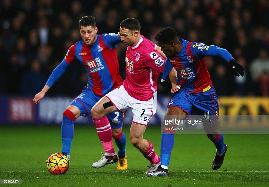 Marc Pugh (C) of Bournemouth competes for the ball against Joel Ward (L) and Wilfried Zaha (R) of Crystal Palace during the Barclays Premier League match between Crystal Palace and A.F.C. Bournemouth at Selhurst Park on February 2, 2016 in London, England.