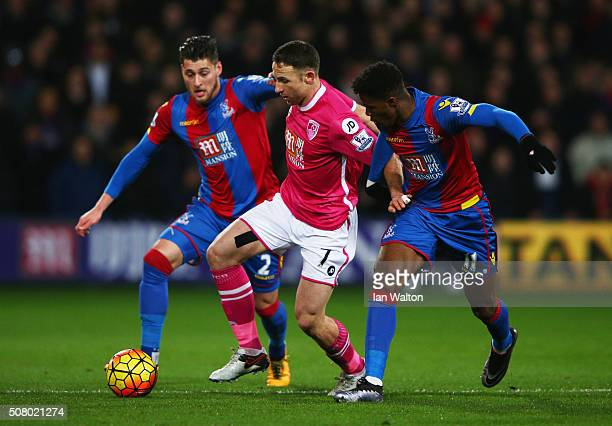 Marc Pugh of Bournemouth competes for the ball against Joel Ward and Wilfried Zaha of Crystal Palace during the Barclays Premier League match between...