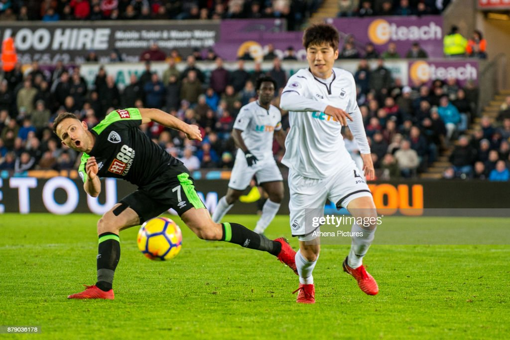 Marc Pugh of Bournemouth ( right ) reacts during the Premier League match between Swansea City and Bournemouth at The Liberty Stadium on November 25, 2017 in Swansea, Wales.