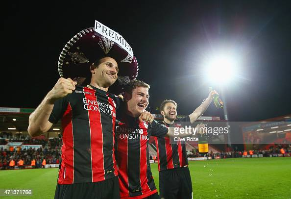 Marc Pugh Ryan Fraser and Harry Arter of Bournemouth celebrate victory on the pitch after the Sky Bet Championship match between AFC Bournemouth and...