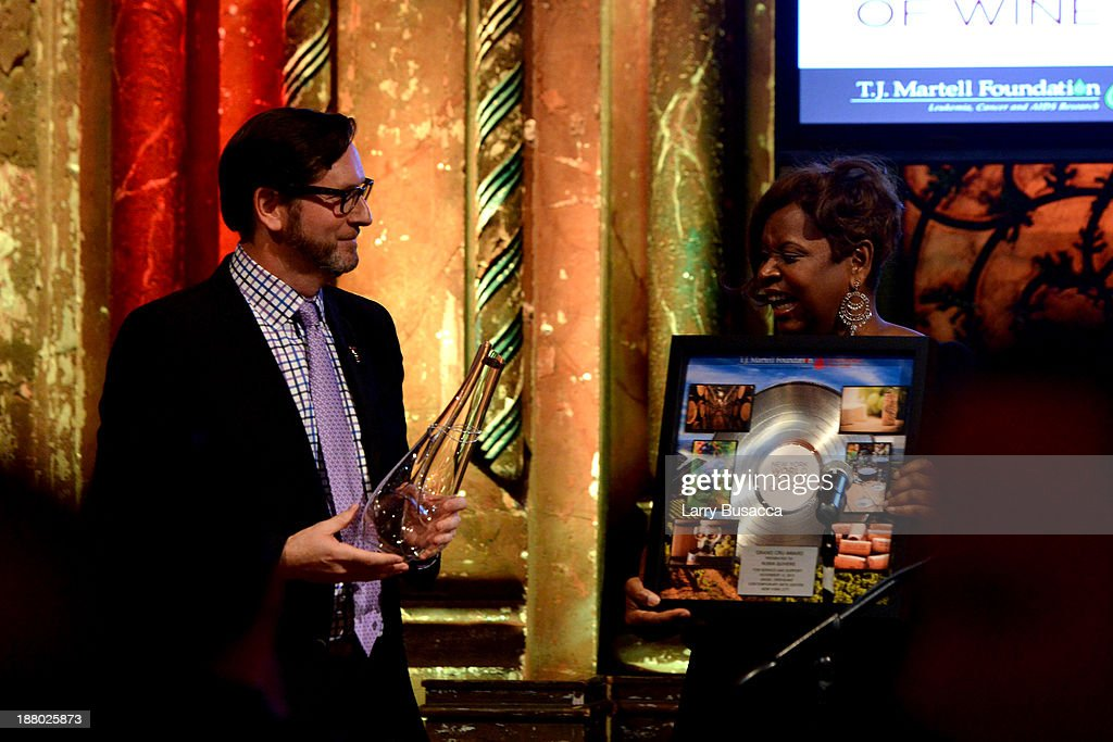 Marc Reiter presents Robin Quivers with an award onstage at T.J. Martell Foundation's Annual World Tour of Wine Dinner at The Angel Orensanz Foundation on November 14, 2013 in New York City.